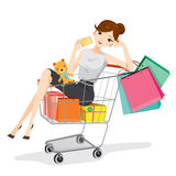 Woman holding card siting in shopping cart Royalty Free Stock Photos
