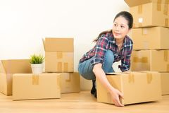 Woman holding cardboard box for moving Royalty Free Stock Photo
