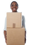 Woman holding cardboard boxes Royalty Free Stock Images