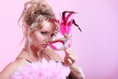 Woman holding carnival mask feather fan in hand Royalty Free Stock Images
