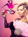 Woman holding carnival mask feather fan in hand Stock Photography