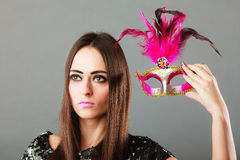 Woman holding carnival mask in hand Stock Photos