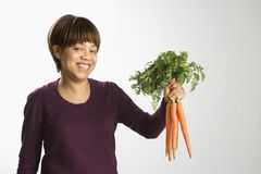 Woman holding carrots. Stock Photography