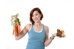 Woman holding carrots and cake healthy nutrition Stock Photos