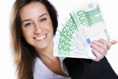 Woman holding cash Royalty Free Stock Image