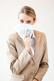 Woman holding cash Royalty Free Stock Images