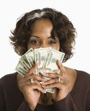 Woman holding cash. Stock Image