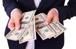 Woman holding cash dollars in hand. Stock Photos