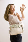 Woman Holding Cash Filled Purse Royalty Free Stock Images