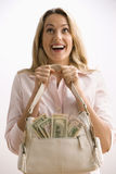 Woman Holding Cash Filled Purse Royalty Free Stock Image