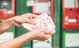 Woman holding cash withdrawn from ATM Stock Photos