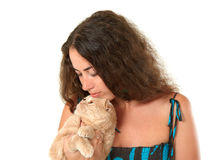 Woman holding cat. Woman holding cream colored cat and looking at him royalty free stock image