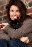 Woman holding a cat Royalty Free Stock Images