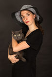 The woman is holding the cat in her arms Royalty Free Stock Images