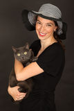 The woman is holding the cat in her arms Royalty Free Stock Photo