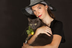 The woman is holding the cat in her arms Stock Images