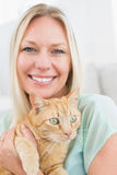 Woman holding cat at home Stock Photos
