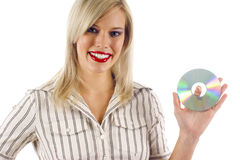 Woman Holding a CD Royalty Free Stock Image