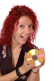 Woman holding CD. Smiling woman holding a gold CD / DVD, isolated on white background stock photography