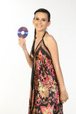 Woman holding CD. Young woman holding CD in white background Stock Photography
