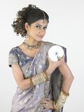 Woman holding  CD in beautiful hairstyle Royalty Free Stock Images