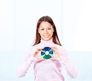 Woman holding cd disk. Brunette woman holding cd disk Royalty Free Stock Image