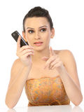 Woman holding cell phone royalty free stock photography