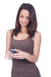 Woman holding a cellphone and smiling Royalty Free Stock Photos