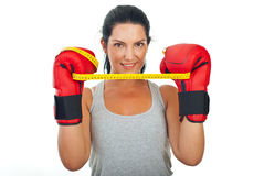 Woman holding centimeter between gloves Royalty Free Stock Photo