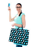 Woman holding cerdit-card with shopping bags Stock Photos