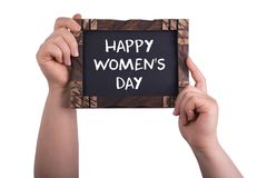 Happy women`s day. A woman holding chalkboard with words happy women`s day isolated on white background stock photography