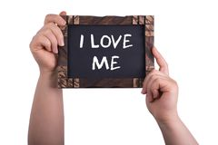 I love me. A woman holding chalkboard with words i love me isolated on white background Royalty Free Stock Image