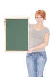 Woman holding a chalkboard Royalty Free Stock Photography