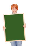 Woman holding a chalkboard Royalty Free Stock Image