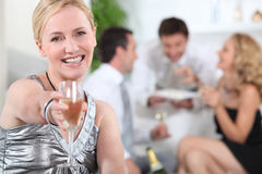 Woman holding champagne Stock Photo