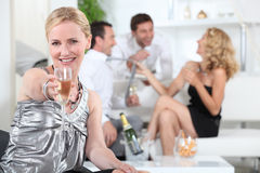 Woman holding champagne Stock Photography