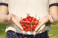 Woman holding cherries Royalty Free Stock Photos