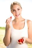 Woman holding cherry tomatoes Royalty Free Stock Images