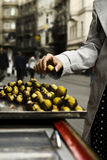 Woman holding chestnut. Outdoor, Istanbul Turkey Stock Photography