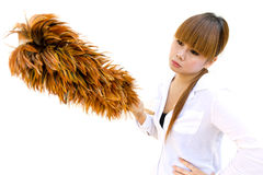 Woman holding an chicken feather duster. Woman boring holding an chicken feather duster Royalty Free Stock Photo