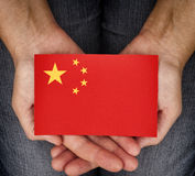Woman holding China flag on her palms Royalty Free Stock Photography