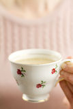 Woman holding china teacup of tea Royalty Free Stock Images