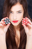 Woman holding chips for gambling royalty free stock images