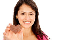 Woman holding a chocolate Royalty Free Stock Photos