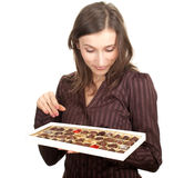 Woman holding chocolate box Royalty Free Stock Images