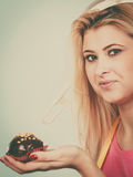 Woman holding chocolate cupcake about to bite Royalty Free Stock Photo