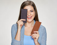 Woman holding chocolate dark and milk. Stock Photography