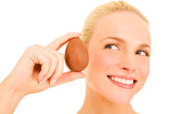 Woman holding a chocolate egg Stock Image
