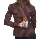 Woman holding chocolate after her back Royalty Free Stock Images