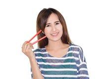Woman holding chopsticks Royalty Free Stock Image